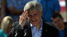 Conservative Leader Stephen Harper wipes his brow as he delivers a speech while making a campaign stop at a farm in Pense, Sask., on Thursday, August 13, 2015. (Sean Kilpatrick/The Canadian Press)