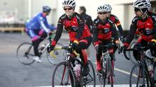Sarah King, left, cycling in the Sears National Kids Cancer Ride, called her cross-Canada journey 'an incredible adventure.' (DAVE CHAN FOR THE GLOBE AND MAIL)