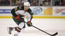 Longtime Minnesota Wild forward Bouchard has announced his retirement, Agent Allan Walsh tweeted Friday, March 18, 2016. (Mark J. Terrill/AP)