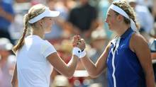 Ekaterina Makarova, left, shakes hands with Victoria Azarenka after their match on day ten of the 2014 U.S. Open tennis tournament at USTA Billie Jean King National Tennis Center. (Jerry Lai/USA Today Sports)