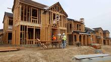 Construction workers build single family homes in San Diego, California March 25, 2013. (MIKE BLAKE/REUTERS)