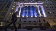 In this Tuesday, Oct. 25, 2016, file photo, a pedestrian walks past the New York Stock Exchange, in lower Manhattan. (Mary Altaffer/AP)
