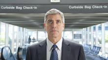 """George Clooney plays a business traveller who lives out of a suitcase, in a scene from """"Up in the Air."""" (Dale Robinette/AP)"""
