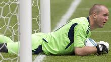 Toronto FC's goalkeeper Stefan Frei reacts as he stops the ball just short of the line after a fumble during second half MLS action during his team's 6-2 defeat to Philadelphia Union in Toronto on Saturday May 28, 2011. THE CANADIAN PRESS/Chris Young (Chris Young)