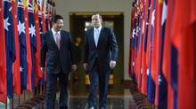Chinese President Xi Jinping and Australian PM Tony Abbott have reason to smile; a trade agreement will see Down Under companies gain a head start. (Getty Images)