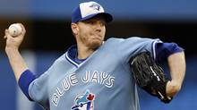 Toronto Blue Jays pitcher Roy Halladay throws against the New York Yankees during the first inning of their MLB American League baseball game in Toronto September 4, 2009. REUTERS/Mike Cassese (MIKE CASSESE)