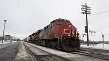 A CN train passes by Dorval station in Montreal, January 23, 2012. (Christinne Muschi For The Globe and Mail)