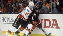 Calgary Flames defenseman Dougie Hamilton pins Anaheim Ducks center Rickard Rakell against the boards while playing for the puck during the second period in Game 1 of the first round of the 2017 Stanley Cup Playoffs at the Honda Center in Anaheim, on April 13, 2017. (Gary A. Vasquez/USA Today Sports)