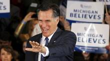 U.S. Republican presidential candidate and former Massachusetts Governor Mitt Romney arrives to address supporters at his Michigan primary night rally in Novi, Michigan, February 28, 2012. (MARK BLINCH)