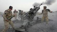 Master Bombardier Rob Penny, left, prepares the next round for the 155 mm-Howitzer, as bombardier Martin Brousseau, right, fires at a target in the Panjwayi District of Afghanistan, a Taliban stronghold, in August, 2008. <137>THE CANADIAN PRESS/Winnipeg Free Press - Joe Bryksa<137> (Joe Bryksa/The Canadian Press)
