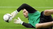 Ireland's goalkeeper David Forde makes a save during a training session at Gdynia municipal stadium June 5, 2012. (AGENCJA GAZETA/REUTERS)