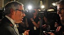 Treasury Board President Tony Clement, shown in the foyer of the House of Commons on Sept. 19, 2011, has been tasked with reducing spending accross all government departments. (Sean Kilpatrick/THE CANADIAN PRESS)
