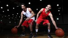This year, Philip Scrubb, right, is averaging a team-high 18.6 points a game for the Carleton Ravens while his brother Thomas, a 6-foot-5 forward, is the team's leading rebounder with an average of 7.3 to go along with 12.2 points. (Dave Chan For The Globe and Mail)