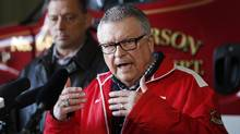 Minister of Public Safety and Emergency Preparedness Ralph Goodale speaks to the media as Greg Janzen, Reeve of Emerson-Franklin, listens in after a visit with officials at the fire hall in Emerson, Manitoba, on March 4, 2017. (JOHN WOODS/THE CANADIAN PRESS)