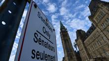 "A ""Senators Only"" parking sign is displayed on Parliament Hill in Ottawa on Nov. 5, 2013. The Globe has found that 46 of Canada's 99 senators have a second job. (Sean Kilpatrick/The Canadian Press)"