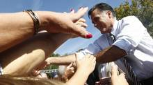 U.S. Republican presidential nominee Mitt Romney greets supporters at a campaign rally in Chesapeake, Virginia, Oct. 17, 2012. (JIM YOUNG/REUTERS)