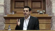 Alexis Tsipras, leader of the Coalition of Radical Left, addresses parliamentarians in Athens on May 9. He declared that the 'barbarous' bailout agreement is now invalid, triggering blunt threats from several European politicians and officials. (YORGOS KARAHALIS/YORGOS KARAHALIS/REUTERS)