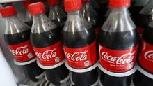 Bottles of Coca-Cola Co. soda are displayed for sale at a convenience store in Redondo Beach, California, U.S., on Monday, July 15, 2013. The new Coca-Cola product, which starts to hit store shelves on Tuesday, will have a lower syrup concentration and about 8 per cent fewer calories – 240 calories for a 591-millilitre bottle of Coke, compared with 260. (Patrick T. Fallon/Bloomberg)