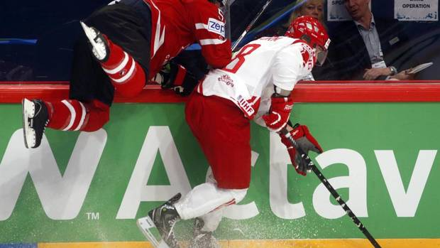 Canada's Brian Campbell (L) crashes into the glass as he fights for the puck with Denmark's Frederik Storm during their 2013 IIHF Ice Hockey World Championship preliminary round match at the Globe Arena in Stockholm May 4, 2013. (ARND WIEGMANN/REUTERS)