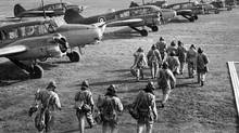 RAF pilots and crew make their way to their Avro Anson planes during the Second World War in September, 1939. (Mirrorpix/Courtesy Everett Collection)