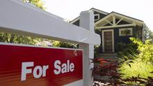 A sold sign is pictured outside a home in Vancouver, B.C., Tuesday, June, 28, 2016. (JONATHAN HAYWARD/THE CANADIAN PRESS)