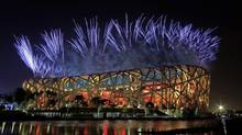 Fireworks explode above the Olympic National Stadium, known as Bird's Nest during a rehearsal for the opening ceremony of the 2008 Beijing Olympic Games, which on Aug. 8 in Beijing, China, Wednesday, July 16, 2008. (AP Photo/Andy Wong) (ANDY WONG/THE ASSOCIATED PRESS)