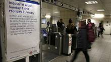 Passengers pass through turnstiles at Waterloo Underground Station in central London on Sunday. The walkout on the Tube is part of a wave of strikes hitting British rail and air passengers at the start of 2017. (PETER NICHOLLS/REUTERS)