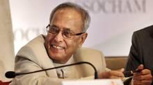 Indian Finance Minister Pranab Mukherjee smiles during a seminar in Mumbai on June 16, 2012. (Rajanish Kakade/AP)