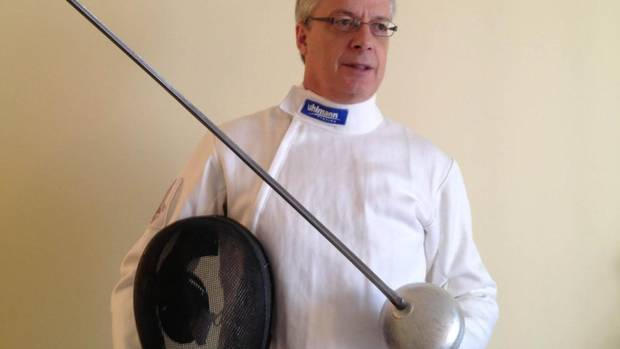 Mark Ballard, founder and president of Toronto-based Charter House Consulting Inc., holds an epee and helmet. Mr. Ballard has become one of North America's top-ranked veteran fencers. (CAROLYN BALLARD/COURTESY OF MARK BALLARD)