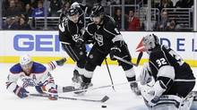 Edmonton Oilers left wing Taylor Hall (4) sweeps a shot at Los Angeles Kings goalie Jonathan Quick (32) with center Trevor Lewis (22) and defenseman Drew Doughty (8) looking on during the third period of an NHL hockey game in Los Angeles, Saturday, March 26, 2016. (Alex Gallardo/AP)