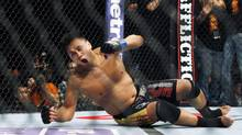 """Cung Le of Vietnam reacts after winning the middleweight match, of the Ultimate Fighting Championship UFC , after beating Rich """"Ace"""" Franklin of the US, at the Venetian Macao, in Macau Sunday, Nov. 11, 2012. Cung Le won by a knock out in the first round. (Kin Cheung/AP)"""