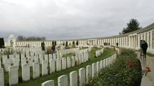 Visitors pay their respects at Tyne Cot cemetery in Belgium, near the site of the bloody Battle of Passchendaele in the First World War. (Virginia Mayo/AP)