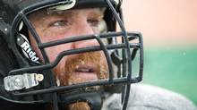 Hamilton Tiger-Cats offensive linemen Tim O'Neill has ice crystals in his mustache as he takes part in practice before the upcoming 101st CFL Grey Cup against the Saskatchewan Roughriders in Regina on Wednesday, Nov. 20, 2013. (Nathan Denette/THE CANADIAN PRESS)