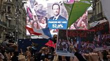 The face of of the newly-elected French President Francois Hollande appears on a giant screen to announce the winner of the 2012 French presidential elections at the Rue de Solferino Socialist Party headquarters in Paris, May 6, 2012. France voted in elections on Sunday and Francois Hollande became the nation's first Socialist president in 17 years, early results said (JEAN-PAUL PELISSIER/Reuters/JEAN-PAUL PELISSIER/Reuters)