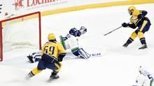 Calle Jarnkrok, top right, scores the winning goal against Canucks goalie Ryan Miller. (Mark Zaleski/AP)