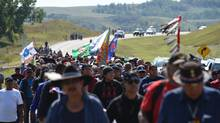 Protestors march to a construction site for the Dakota Access Pipeline to express their opposition to the pipeline, at an encampment where hundreds of people have gathered to join the Standing Rock Sioux Tribe's to protest against the construction of the new oil pipeline, near Cannon Ball, North Dakota, on September 3, 2016. The Indian reservation in North Dakota is the site of the largest gathering of Native Americans in more than 100 years. Indigenous people from across the US are living in camps on the Standing Rock reservation as they protest the construction of the new oil pipeline which they fear will destroy their water supply. (Robyn Beck/AFP/Getty Images)