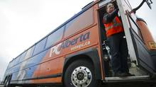 Greg Podulsky, driver, cleans and checks Alberta premier Alison Redford's campaign bus in Edmonton, Alberta on March 25, 2012. (Ian Jackson for The Globe and Mail/Ian Jackson for The Globe and Mail)