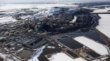Suncor Oil Sands operation, near where officials were seen taking samples for the Athabasca River, following a pipeline carrying industrial waste water ruptured, Tuesday, March, 26, 2013 in Fort McMurray,Alberta. (Brett Gundlock/ Boreal Collectiv For The Globe and Mail)