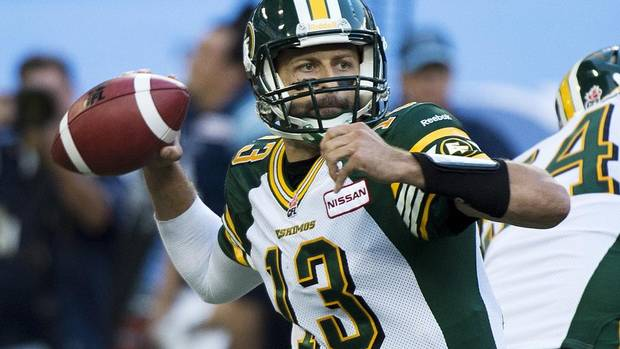 Edmonton Eskimos quarterback Mike Reilly throws the ball while playing against the Toronto Argonauts during first half CFL football action in Toronto, on Sunday, August 18, 2013. (NATHAN DENETTE/THE CANADIAN PRESS)