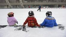 From left, eighteen month Faye James, Olivia Akiyama 3, and Greta James, 3 (Faye's sister) take a short break while skating at Nathan Phillip Square during an outing with their parents, while on a day trip from Peterborough, Ont. on Dec 6 2010. (Fred Lum/The Globe and Mail)