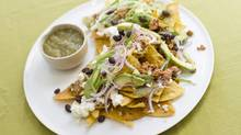 Chilaquiles are great for a big group because there are plenty of options to appease those with dietary restrictions. (Tim Fraser For The Globe and Mail)