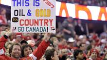 Canada hockey fans wait for the start of the Canada versus United States game at the IIHF World Junior Championships hockey action in Edmonton on Saturday, Dec. 31, 2011. (THE CANADIAN PRESS/Nathan Denette/THE CANADIAN PRESS/Nathan Denette)