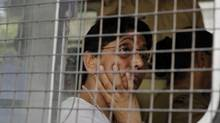 Former Gujarat minister and a member of India's main opposition Bharatiya Janata Party (BJP) Maya Kodnani, in a police vehicle, arrives at a special court in Ahmedabad, India, Friday, Aug. 31, 2012. (Ajit Solanki/AP)