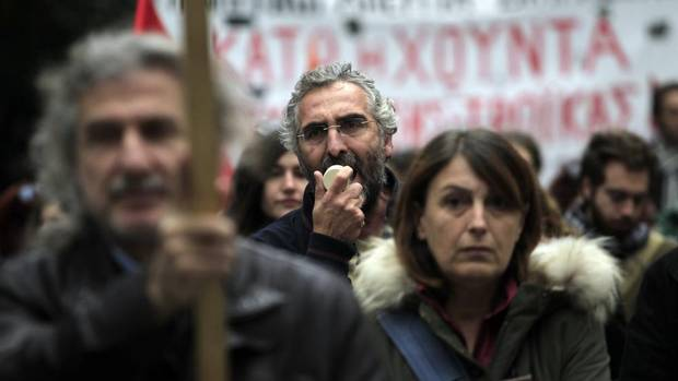 Protesters chant slogans during a union protest in Thessaloniki, Greece on Nov. 14, 2012. Workers across the European Union sought to present a united front against rampant unemployment and government spending cuts Wednesday with a string of strikes and demonstrations across the region. (Nikolas Giakoumidis/AP)