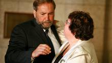 Thomas Mulcair is comforted by fellow deputy NDP leader Libby Davies while Jack Layton's casket lies in state in the foyer of House of Commons on Aug. 24, 2011. (Dave Chan/Dave Chan for The Globe and Mail)