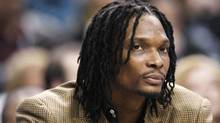 Toronto Raptors Chris Bosh sits on the bench as his team plays the New York Knicks during the first half of their NBA basketball game in Toronto April 14, 2010. (MARK BLINCH/REUTERS)