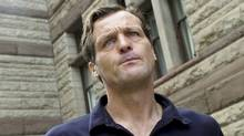 Alleged bike theft ring leader Igor Kenk, clean shaven at the time, leaves Old City Hall Courts in Toronto. (Sami Siva/Sami Siva / The Globe and Mail)