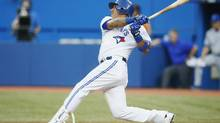 Toronto Blue Jays Yunel Escobar watches his RBI sacrifice fly against the Kansas City Royals during the third inning of their MLB American League game in Toronto on Wednesday. (Mark Blinch/Reuters)