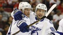 Tampa Bay Lightning center Steven Stamkos, left, is returning home for further evaluation of a right leg injury suffered during a victory over the Red Wings. (Paul Sancya/THE ASSOCIATED PRESS)