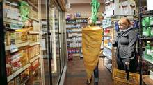 Mary Fay Coady, dressed as a giant carrot, at G?s Fine Foods in Toronto during a Carrotmob, in which a crowd of shoppers all go to one store. (Jennifer Roberts for The Globe and Mail)